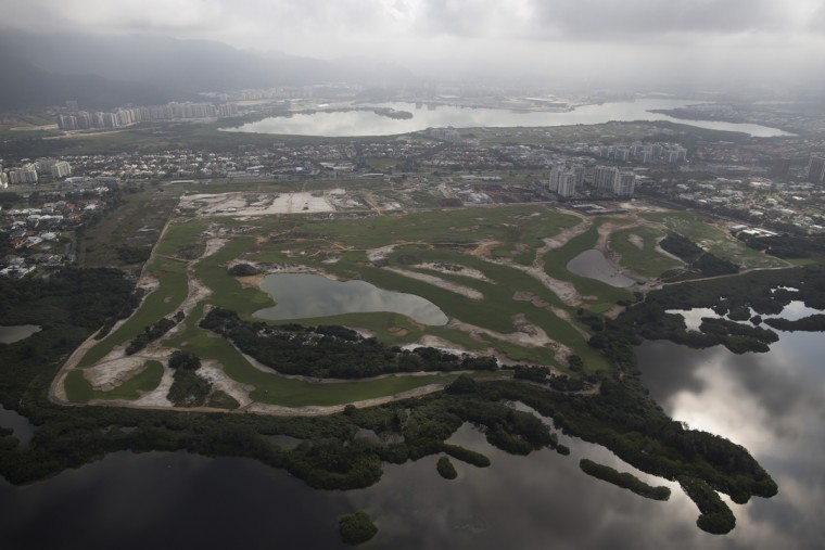 The Olympic golf course is seen under construction in Rio de Janeiro, Brazil, Monday, July 27, 2015. The golf course is part of two high-profile legacy projects that also includes the Athletes' Village, which are primarily real estate developments anchored by luxury apartments. (AP Photo/Leo Correa)