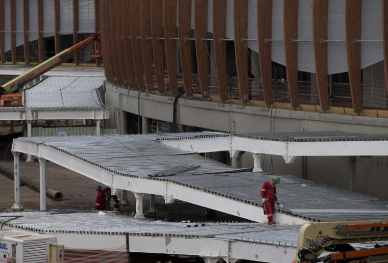 "In this July 22, 2015 photo, personnel work on the Carioca Arena 1, for the 2016 Rio Olympics, in Rio de Janeiro, Brazil. The head of the local organizing committee Carlos Nuzman says Rio will be the Olympic city with the ""greatest transformation,"" surpassing Tokyo in 1964 and Barcelona in 1992. (AP Photo/Silvia Izquierdo)"