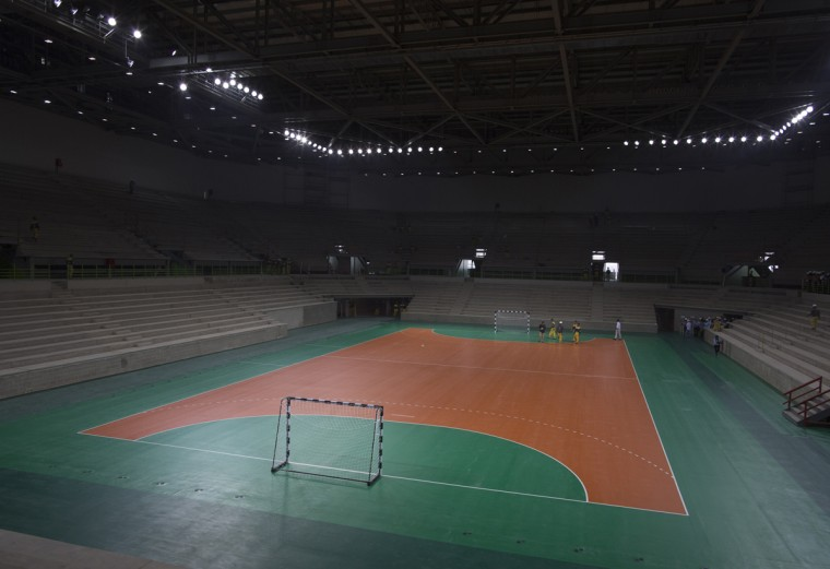 The Olympic handball court is illuminated inside an arena under construction at Olympic Park in Rio de Janeiro, Brazil, Wednesday, Aug. 5, 2015. Rio de Janeiro Mayor Eduardo Paes said on Wednesday all the venues for South America's first games are on track to be ready when the curtain comes up on Aug. 5 next year. (AP Photo/Leo Correa)