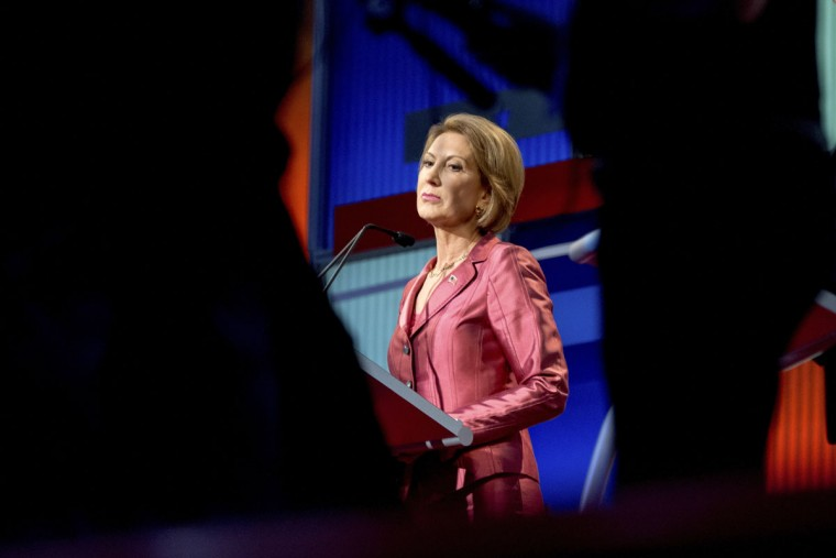 Republican presidential candidate Carly Fiorina stands on stage during a commercial break while participating in a pre-debate forum at the Quicken Loans Arena, Thursday, Aug. 6, 2015, in Cleveland. Seven of the candidates have not qualified for the primetime debate. (AP Photo/Andrew Harnik)