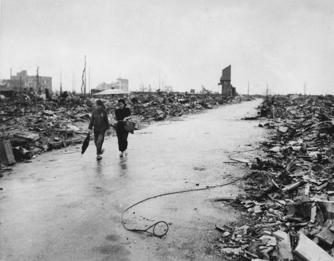 FILE - In this Sept. 8, 1945 file photo, two people walk on a cleared path through the destruction resulting from the Aug. 6 detonation of the first atomic bomb in Hiroshima, western Japan. On Aug. 6, 1945, a U.S. plane dropped an atomic bomb on Hiroshima, the first nuclear weapon has been used in war. Japan surrendered on Aug. 15, ending World War II. (AP Photo/U.S. Air Force, File)