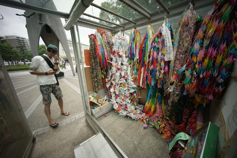 "In this July 5, 2015 photo, a visitor stands near the symbolic ""Thousand Cranes"" near Hiroshima Peace Memorial Museum in Hiroshima, western Japan. On Aug. 6, 1945, a U.S. plane dropped an atomic bomb on Hiroshima, the first nuclear weapon has been used in war. Japan surrendered on Aug. 15, ending World War II. (AP Photo/Eugene Hoshiko)"