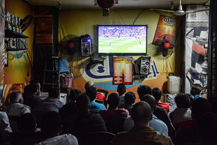 Men watch a soccer match at a local cafe in Cairo, Egypt. Egyptian authorities have banned fans from attending football games, citing ongoing tension between security forces and Ultras groups since a 2012 stadium disaster in Port Said in which at least 72 football fans were killed. (AP Photo/Mohammed El Raai)