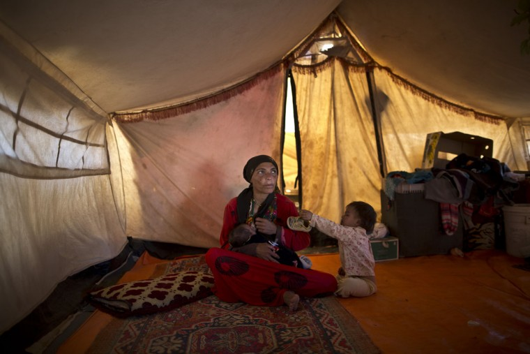 In this Sunday, July 26, 2015 photo, Syrian refugee Wazeera Elaiwi, 29, breast-feeds her newly born son Mohammed, 43 days, inside her tent at an informal settlement near the Syrian border on the outskirts of Mafraq, Jordan. Aid agencies asked for $4.5 billion for 2015 to help refugees, but have been forced to slash support programs because of large funding gaps. Thatís had a devastating effect on the amount of food aid coming. (AP Photo/Muhammed Muheisen)