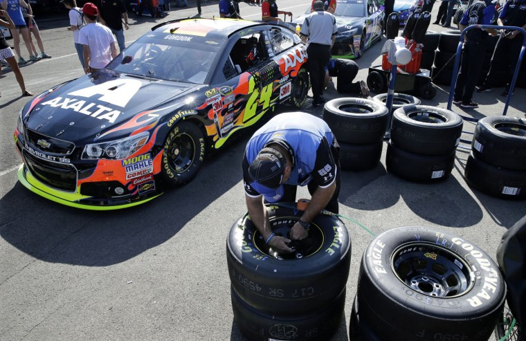 A crew member works in the garage area as teams prepare for Sunday's NASCAR Sprint Cup series auto race at Watkins Glen International, Friday, Aug. 7, 2015, in Watkins Glen, N.Y. (AP Photo/Mel Evans)