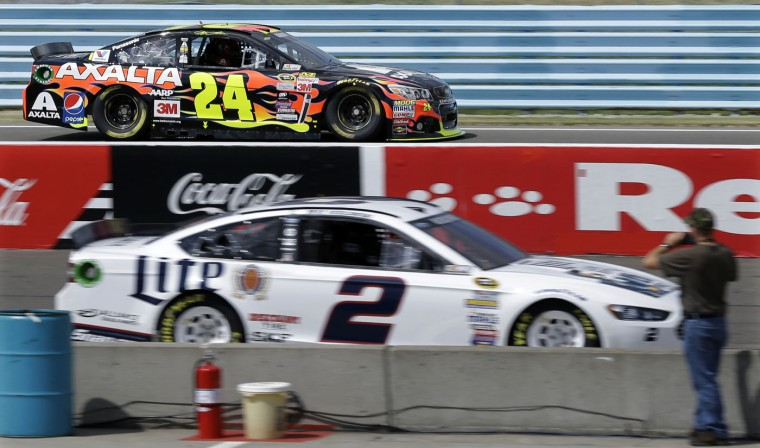 Jeff Gordon (24) drives past Brad Keselowski (2) during practice for Sunday's NASCAR Sprint Cup series auto race at Watkins Glen International, Friday, Aug. 7, 2015, in Watkins Glen, N.Y. (AP Photo/Mel Evans)