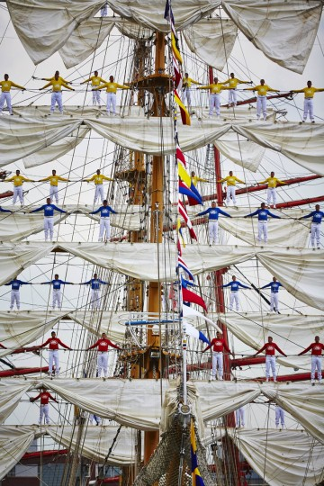 Sailors stand in the rigging of Columbian tall ship ARC Gloria as it arrives in Amsterdam, Netherlands, Wednesday, Aug. 19, 2015, to participate in SAIL Amsterdam 2015, a five-yearly festival celebrating the Dutch capital's maritime history that is expected to draw some 2 million visitors. The 9th edition of the nautical event lasts until Sunday, Aug. 23 on and around the IJ river. (AP Photo/Phil Nijhuis)