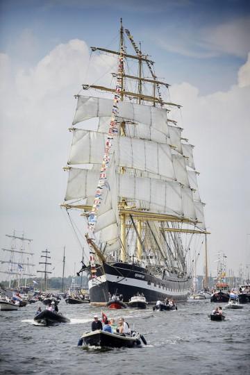 The Russian ship Kruzenshtern arrives in Amsterdam, Netherlands, Wednesday, Aug. 19, 2015, to participate in SAIL Amsterdam 2015, a five-yearly festival celebrating the Dutch capital's maritime history that is expected to draw some 2 million visitors. The 9th edition of the nautical event lasts until Sunday, Aug. 23 on and around the IJ river. (AP Photo/Phil Nijhuis)