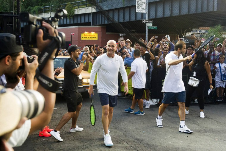 Andre Agassi, left, and Pete Sampras play in Nike's Street Tennis Pro Event in Greenwich Village on Monday, Aug. 24, 2015, in New York. (Charles Sykes/AP)