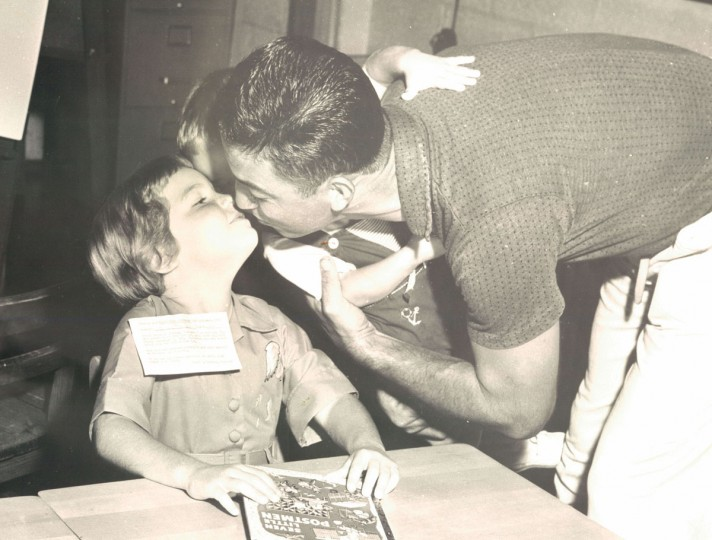 Kathleen Lombardi gets a kiss from father Nick Lombardi after being dropped of at school. (Edward Nolan/Baltimore Sun, 1961)