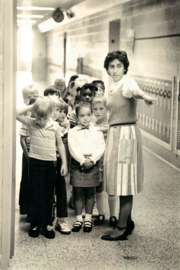 Anna Marchesi, first grade teacher at Mars Estate Elementary School, lines her students up for a practice run of going to the cafeteria for lunch. (Robert K. Hamilton/Baltimore Sun, 1985)
