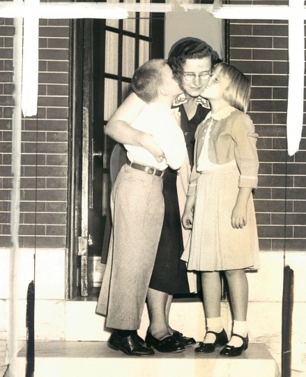 September 9, 1953 - WIN KISSES -- Mrs. William Krause, of 427 North Patterson Park avenue, sends Billy and Mary, 6, marching off to first grade. (Richard Stacks/Baltimore Sun)
