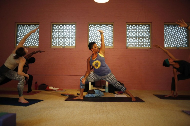 Camille Moses-Allen is a yoga instructor at Charm City Yoga and MAC Harbor East. Learn more about her. (Tom Brenner / Baltimore Sun)