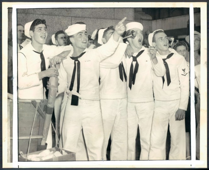August 15, 1945 - LOOK GUYS, IT'S OVER -- Young sailors on leave, read announcement on Sun's Translux sign and express their satisfaction. (LeRoy B. Merriken/Baltimore Sun)
