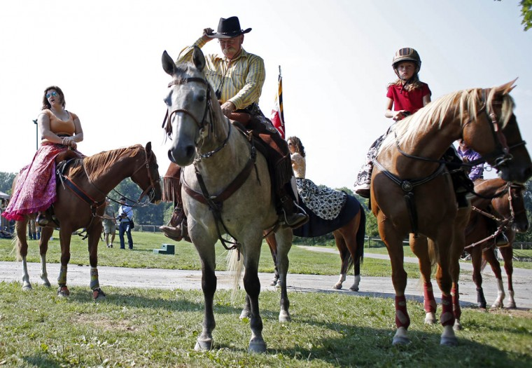 From left to right: Samantha Davis, Mark Mangus, and Hailey Renshaw sit on their horses during a competition at Willowbrook Farms. (Tom Brenner, Baltimore Sun)