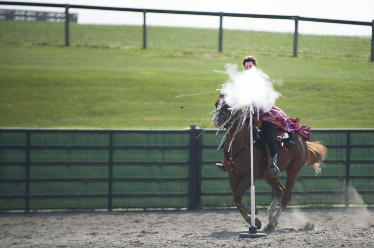 Samantha Davis shoots a balloon during a stage during a competition at Willowbrook Farms. (Tom Brenner, Baltimore Sun)