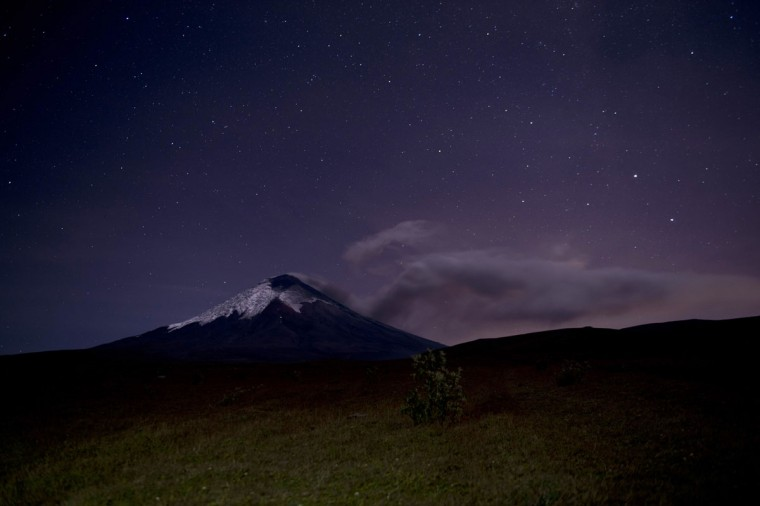 View from EL Pedregal of the Cotopaxi volcano in Ecuador spewing ashes on August 22, 2015. Nearly 325,000 people could be affected by an eruption of Cotopaxi, the volcano looming beyond the Ecuadoran capital of Quito, officials said Monday. The biggest risk is from an eruption melting the 5,900-metre (19,000-foot) mountain's snowcap and triggering massive melt-water floods and lahar mudflows that could sweep through nearby towns, Ecuador's minister of risk management Maria del Pilar Cornejo told a press conference. (MARTIN BERNETTI/AFP/Getty Images)