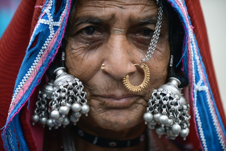 An Indian Lambadi tribal woman watches artists dance at a performance in Hyderabad on the eve of International Day of the World's Indigenous Peoples on August 8, 2015. The International Day of the World's Indigenous Peoples is observed on August 9 each year. (Noah Seelam/AFP-Getty Images)