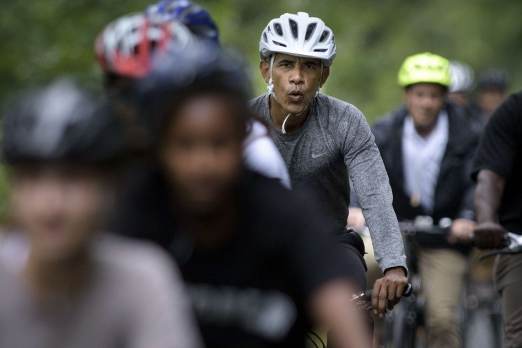 The first family, including U.S. President Barack Obama, bike ride August 22, 2015 in Vineyard Haven, Massachusetts on Martha's Vineyard. (Brendan Smialowski/AFP-Getty Images)