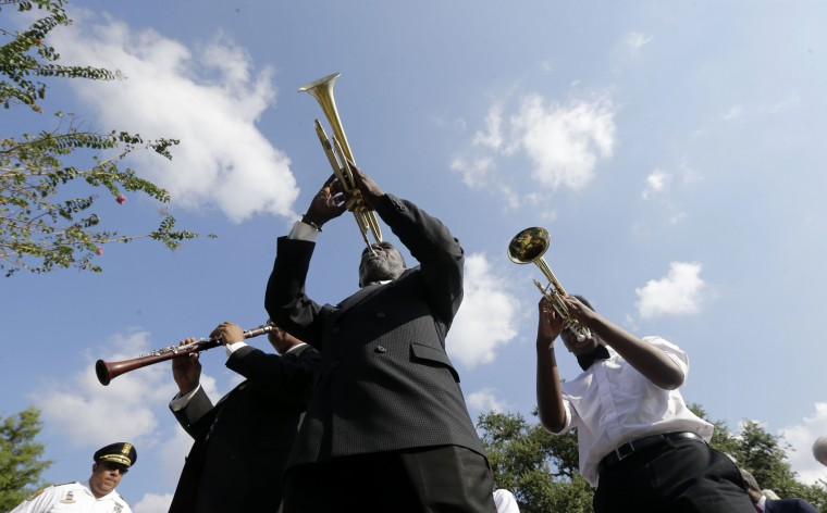 Musicians lead the procession during a wreath laying ceremony at the Hurricane Katrina Memorial, on the 10th anniversary of Hurricane Katrina in New Orleans, Saturday, Aug. 29, 2015. (Gerald Herbert/Associated Press)