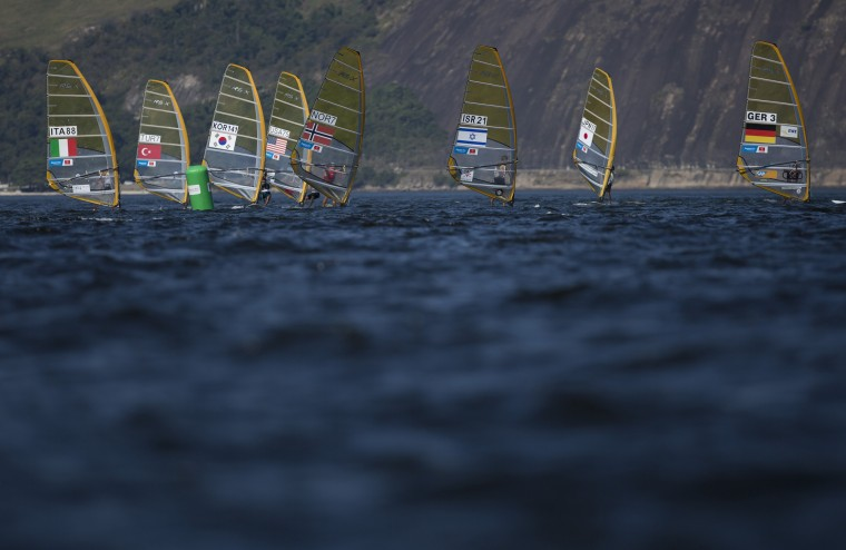 Men compete in the RS:X Windsurfer event during a sailing test, ahead of the Rio 2016 Olympic Games, in Guanabara Bay in Rio de Janeiro, Brazil, Saturday, Aug. 15, 2015. (Leo Correa/Associated Press)