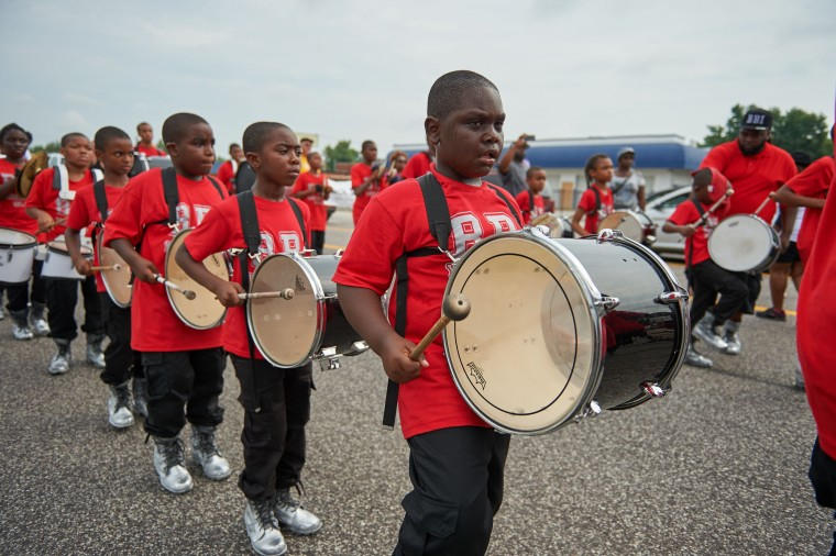 Children play as a part of a marching band during a march of solidarity on West Florissant Avenue on August 8, 2015 in Ferguson, Missouri. As the embattled community celebrates the one-year anniversary of the shooting of Michael Brown Jr. by a Ferguson police officer, there are a wide range of social events and civil disobedience actions throughout the St. Louis, Missouri area. (Michael B. Thomas/AFP-Getty Images)