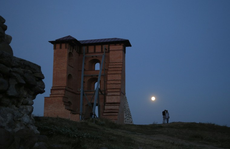 A perigee moon, also known as a super moon, rises above the remains of a medieval fortress in the town of Novogrudok, 150 kilometers (93 miles) west of the capital Minsk, Belarus, Saturday, Aug. 29, 2015. The supermoon happens when moon is full and makes it closest approach to Earth in her orbit. (Sergei Grits/Associated Press)
