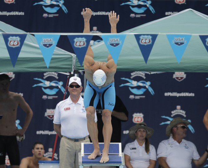 Michael Phelps prepares to compete in the preliminary round of the men's 100-meter butterfly at the the U.S. swimming nationals, Saturday, Aug. 8, 2015, in San Antonio. (Eric Gay/Associated Press)