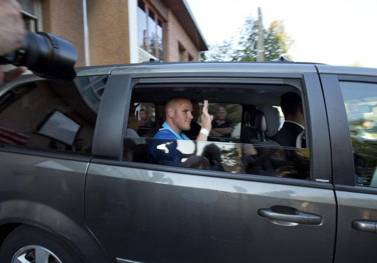U.S. Spencer Stone waves as he leaves the police station in Arras, northern France, Saturday, Aug. 22, 2015. A gunman prepared to open fire with an automatic weapon on a high-speed train traveling from Amsterdam to Paris Friday, wounding several people before being subdued by passengers, officials said. Spencer Stone is one of the passengers credited with subduing the gunman. (Virginia Mayo/Associated Press)