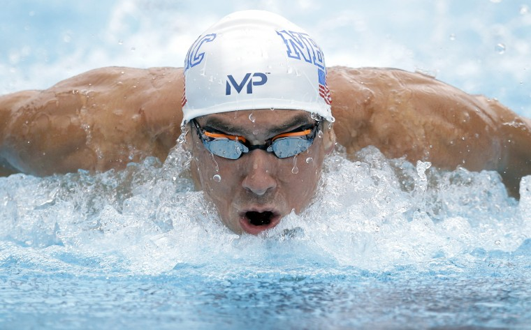 Michael Phelps competes in the preliminary round of the men's 100-meter butterfly at the the U.S. swimming nationals, Saturday, Aug. 8, 2015, in San Antonio, Texas. (Eric Gay/Associated Press)
