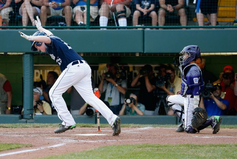 Clayton Krauss #25 of the Mid-Atlantic team from Red Land Little League of Lewisberry, Pennsylvania (C) celebrates after hitting a walk off single against the Southwest team from Pearland West Little League of Pearland, Texas for a 3-2 win during the United States Championship game of the Little League World Series at Lamade Stadium on August 29, 2015 in South Willamsport, Pennsylvania. (Rob Carr/Getty Images)