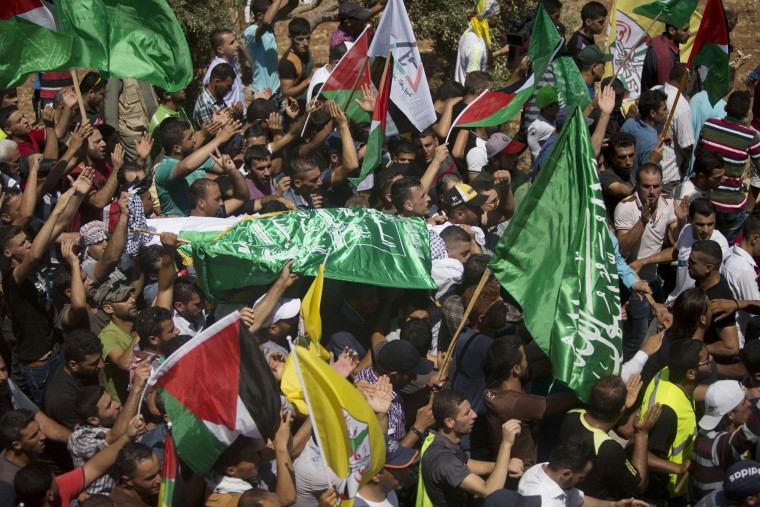 Palestinians carry the body of Saed Dawabsheh, 32, during his funeral procession in the West Bank village of Duma near Nablus on Saturday, Aug. 8, 2015. The father of a Palestinian toddler killed in a July 31 firebomb attack blamed on Jewish extremists has died of wounds sustained in the same incident, his family said Saturday. His 18-month-old toddler perished in the flames, while his 4-year-old brother and parents were seriously hurt. (Majdi Mohammed/Associated Press)