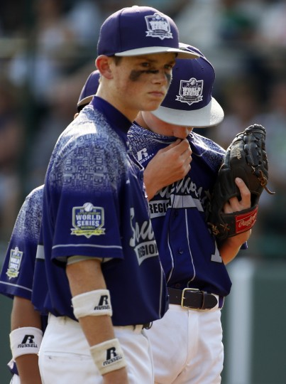 Pearland, Texas' Ryan Farmer, right, and Jarrett Tadlock stand on the mound after Farmer gave up a solo-home run to Lewisberry, Pa.'s Jaden Henline in the fourth inning of the United States championship baseball game at the Little League World Series tournament in South Williamsport, Pa., Saturday, Aug. 29, 2015. Lewisberry, Pa. won 3-2 and will face Japan in Sunday's World Series Championship game. (Gene J. Puskar/Associated Press)