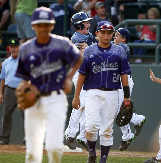Lewisberry, Pa.'s Chayton Krauss, center rear, celebrates with a teammate as Pearland, Texas' Zack Mack (24), and pitcher Marco Gutierrez, left, walk off the field after Krauss drove in the game-winning run with a walk-off single in the sixth inning of the United States championship baseball game at the Little League World Series tournament in South Williamsport, Pa., Saturday, Aug. 29, 2015. Lewisberry, Pa. won 3-2 and will face Japan in the World Series Championship game Sunday. (Gene J. Puskar/Associated Press)
