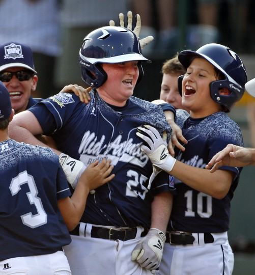 Lewisberry, Pa.'s Chayton Krauss (25) celebrates with teammate Adam Cramer (10) after driving in the game-winning run with a walk-off single off Pearland, Texas' Marco Gutierrez in the sixth inning of the United States championship baseball game at the Little League World Series tournament in South Williamsport, Pa., Saturday, Aug. 29, 2015. Lewisberry, Pa. won 3-2. (Gene J. Puskar/Associated Press)