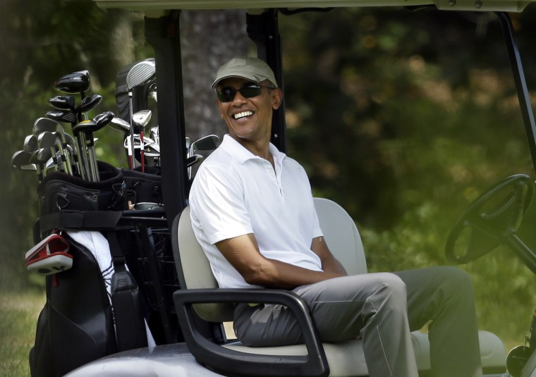 President Barack Obama smiles as he sits in a cart while golfing Saturday, Aug. 15, 2015, at Farm Neck Golf Club, in Oak Bluffs, Mass., on the island of Martha's Vineyard. (Steven Senne/Associated Press)