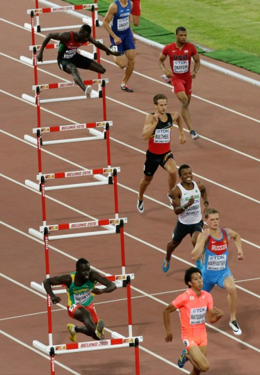 Competitors race in a first round heat of the men's 400m hurdles at the World Athletics Championships at the Bird's Nest stadium in Beijing, Saturday, Aug. 22, 2015. (Wong Maye-E/Associated Press)