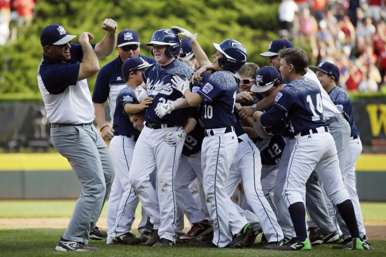 Lewisberry, Pa. players celebrate after the game-winning hit by Chayton Krauss (25) during the sixth inning of the United States Championship baseball game against Pearland, Texas at the Little League World Series tournament, Saturday, Aug. 29, 2015, in South Williamsport, Pa. Lewisberry won 3-2. (Matt Slocum/Associated Press)