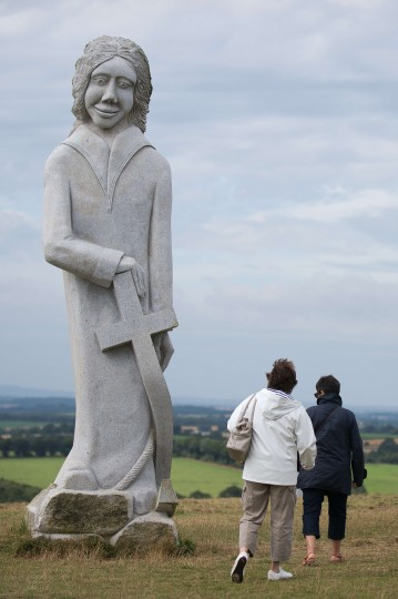 People walk by the statue of a Breton Saint in Carnoet, western France, on the site of the Valley of Saints (Vallee des Saints). The Valley of Saints is a sort of contemporary Easter Island in Brittany with some 60 monumental sculptures of Breton Saints. 100,000 people visited this valley in 2014, which was inaugurated in 2012. (Jean-Sebastian Evrard/AFP-Getty Images)