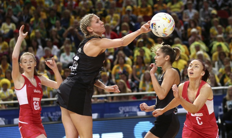 New Zealand's Laura Langman, center, pushes the ball away from England's Jade Clarke, right, during their Netball World Cup semifinal match in Sydney Saturday, Aug. 15, 2015. (Rob Griffith/Associated Press)