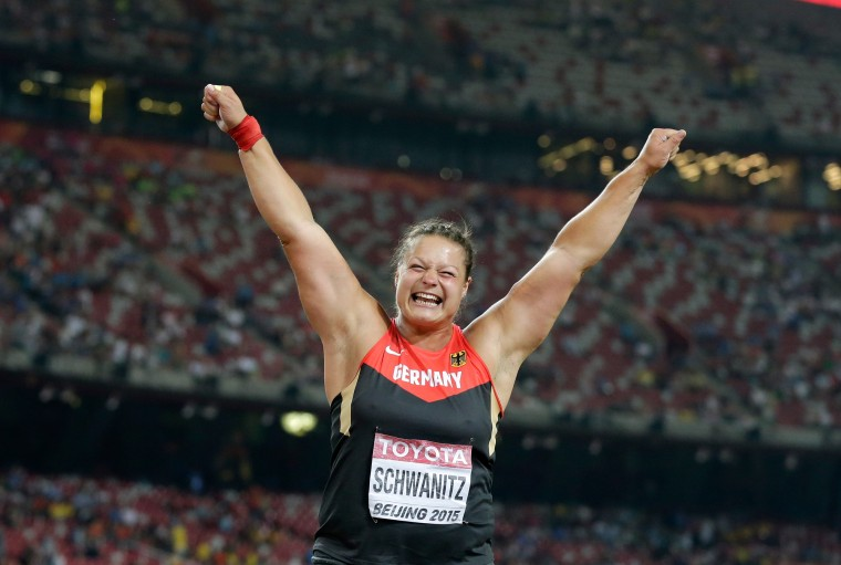 Germany's Christina Schwanitz celebrates after winning the gold medal in the final of the women's shot put at the World Athletics Championships at the Bird's Nest stadium in Beijing, Saturday, Aug. 22, 2015. (Andy Wong/Associated Press)