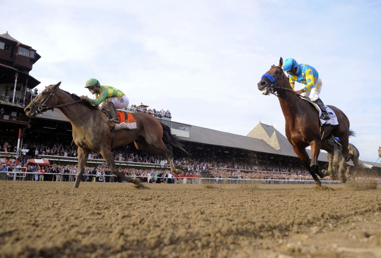 Keen Ice, left, with jockey Javier Castellano, moves past Triple Crown winner American Pharoah, with Victor Espinoza, to win the Travers Stakes horse race at Saratoga Race Course in Saratoga Springs, N.Y., Saturday, Aug. 29, 2015. (Hans Pennink/Associated Press)