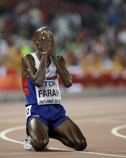 Britain's Mo Farah reacts after winning the men's 10,000m final at the World Athletics Championships at the Bird's Nest stadium in Beijing, Saturday, Aug. 22, 2015. (David J. Phillip/Associated Press)