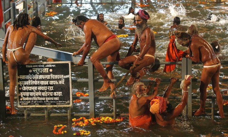 Naga sadhus, or naked Hindu holy men take holy dip in the Godavari River during Kumbh Mela, or Pitcher Festival, at Trimbakeshwar in Nasik, India, Saturday, Aug. 29, 2015. Hindus believe taking a dip in the waters of a holy river during the festival, will cleanse them of their sins. According to Hindu mythology, the Kumbh Mela celebrates the victory of gods over demons in a furious battle over a nectar that would give them immortality. (Rajanish Kakade/Associated Press)
