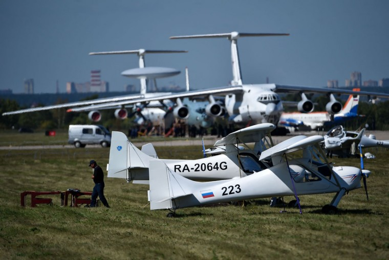 Technicians prepare Ilyushin Il-76TD long-haul cargo aircrafts (background) for the upcoming MAKS-2015, the International Aviation and Space Show, in Zhukovsky, outside Moscow, on August 21, 2015. The MAKS-2015 will be held in Zhukovsky from August 25 to 30. (KIRILL KUDRYAVTSEV/AFP/Getty Images)