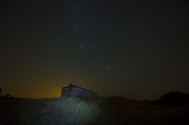 "Stars seen as streaks from a long camera exposure are seen behind an ancient Hermitage, in Murillo del Fruto, northern Spain, Wednesday Aug. 12, 2015. Some Catholics refer to the Perseids as the ""tears of Saint Lawrence"", since August 10 is the date of that saint's martyrdom. (AP Photo/Alvaro Barrientos)"