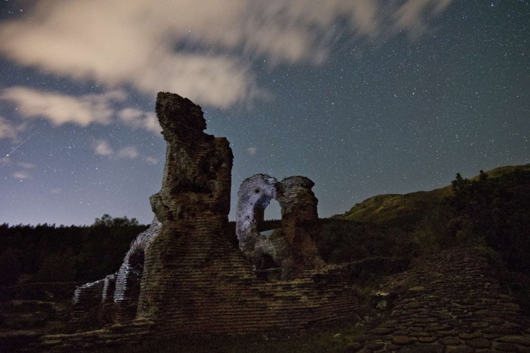 A long exposure image showing a Perseids meteor streaking across the night sky over the remains of St. Ilia Roman, an early Christian basilica dated back to the 5th or 6th century AD near the town of Pirdop, early on August 12, 2015. The Perseid meteor shower occurs every year in August when the Earth passes through the debris and dust of the Swift-Tuttle comet. The Perseid meteor shower -- an annual display of natural fireworks -- should be particularly spectacular this year, with extra-dark skies expected to create optimal stargazing conditions, astronomers said on August 7, 2015. (NIKOLAY DOYCHINOV/AFP/Getty Images)