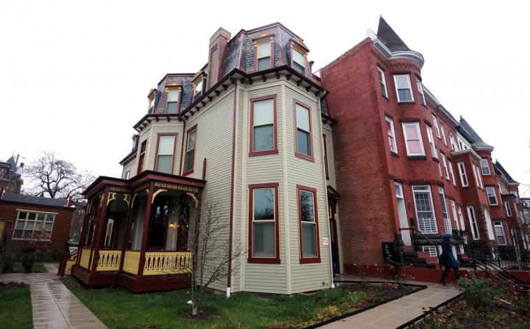 The house with the porch is the Gertrude Stein's family home in Reservoir Hill at 2408 Linden Ave., which is now owned by the women's Housing Coalition. (Baltimore Sun photo by Algerina Perna, Nov. 27, 2013)