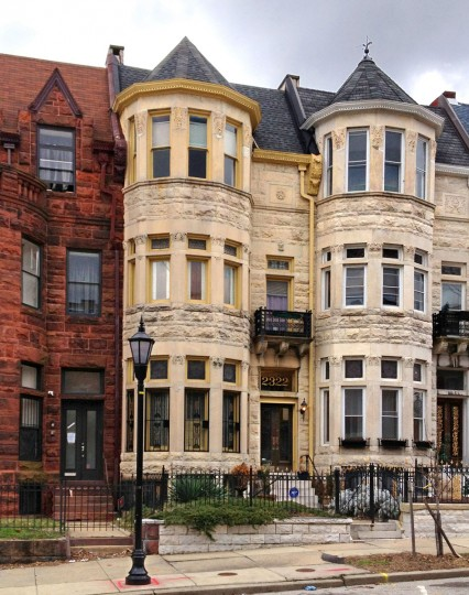 This light-colored 1907 Victorian rowhouse with three-story turret at left, in Reservoir Hill, was in the process of restoring from three rental units to a single-family home with a basement rental apartment. (Amy Davis / Baltimore Sun)