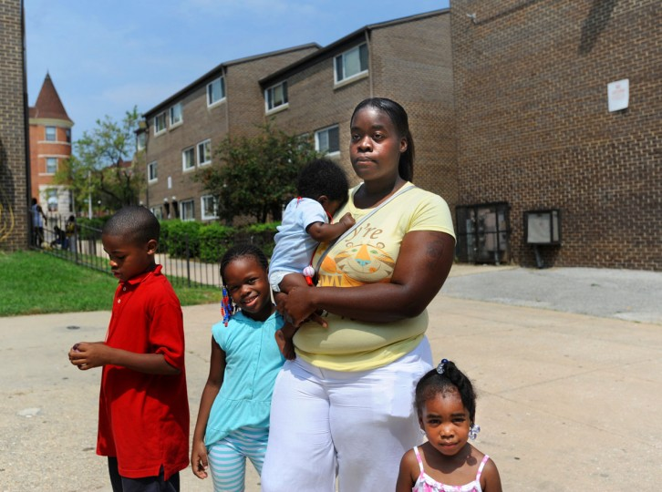 Ciera Witherspoon, a resident of Reservoir Hill's Madison Park North Apartment complex for five years, stands with four of her seven children in one of the apartment courtyards on Aug. 17, 2010. (Barbara Haddock Taylor / Baltimore Sun)